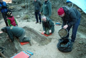 Collecting soil from the mass grave