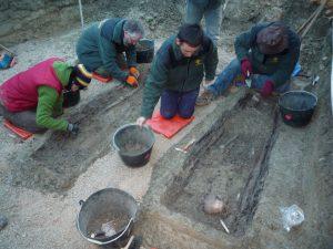Members of Aranzadi exhuming the mass grave